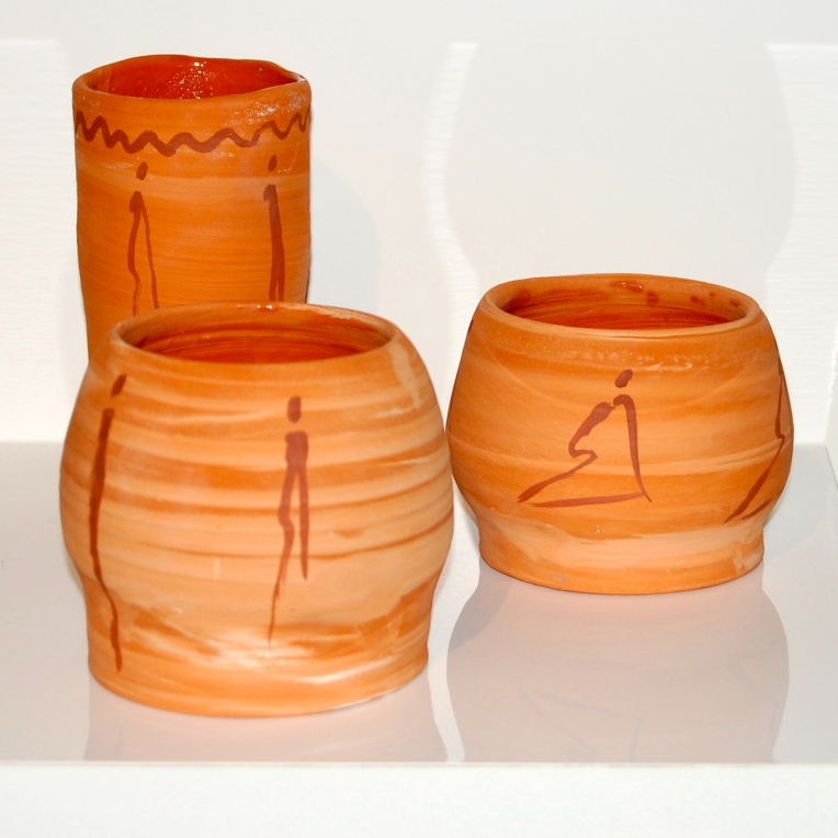 Terracotta bowls with iron oxide silhouettes