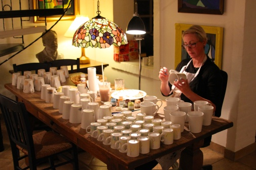 Cosy atmosphere. Painting Silhouette Design Denmark Mugs into the night.