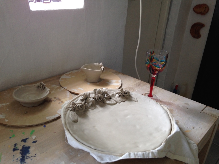 Cake plate, jug and sugar bowl drying in the pottery studio