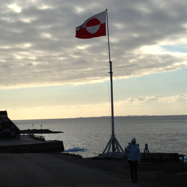 Here I am under the flag of Greenland in Nuuk