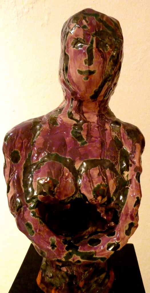 'Empty Womb' purple and black glaze over white clay